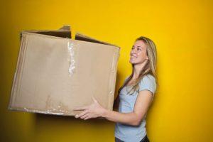 Woman holding a box.