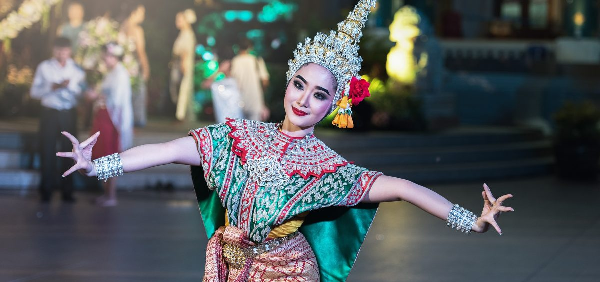 A woman in traditional Thai clothes during a festival.