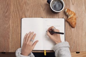 A girl writing something.