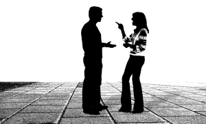 Silhouettes of a man and woman talking