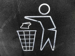 Items you don't have to pack - Drawing of man throwing garbage