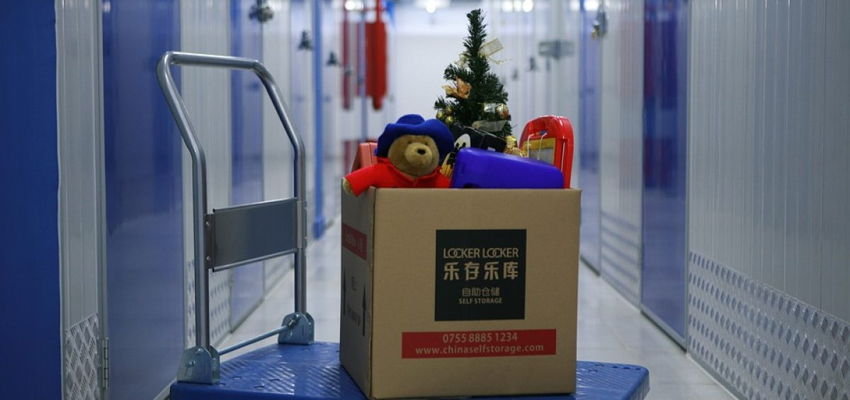 row of self storage with a box on a dolly