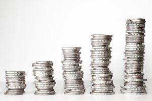 Progressively larger stacks of coins.
