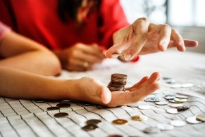 Two people counting coins.