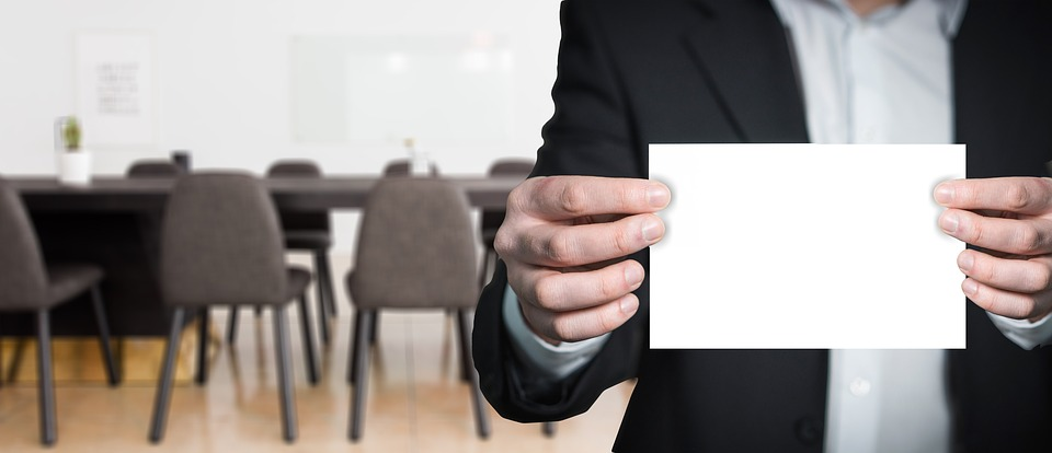 Businessman, holding a blank paper
