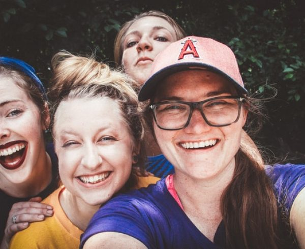 happy millennials taking a photo