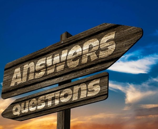 Questions and answers sign - Questions you shouldn't forget to ask before relocating for a job.