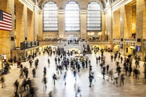 Photo of Grand Central station in NY ful of people rushing about.