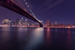 A view of the Brooklyn Bridge by night.