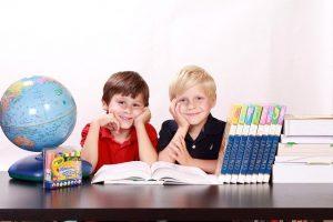 Two boys in school.