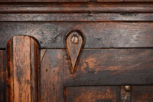 A detail on a wooden furniture item.