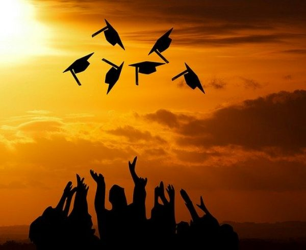 College graduates throwing caps in the air and wondering where to move after graduating college.