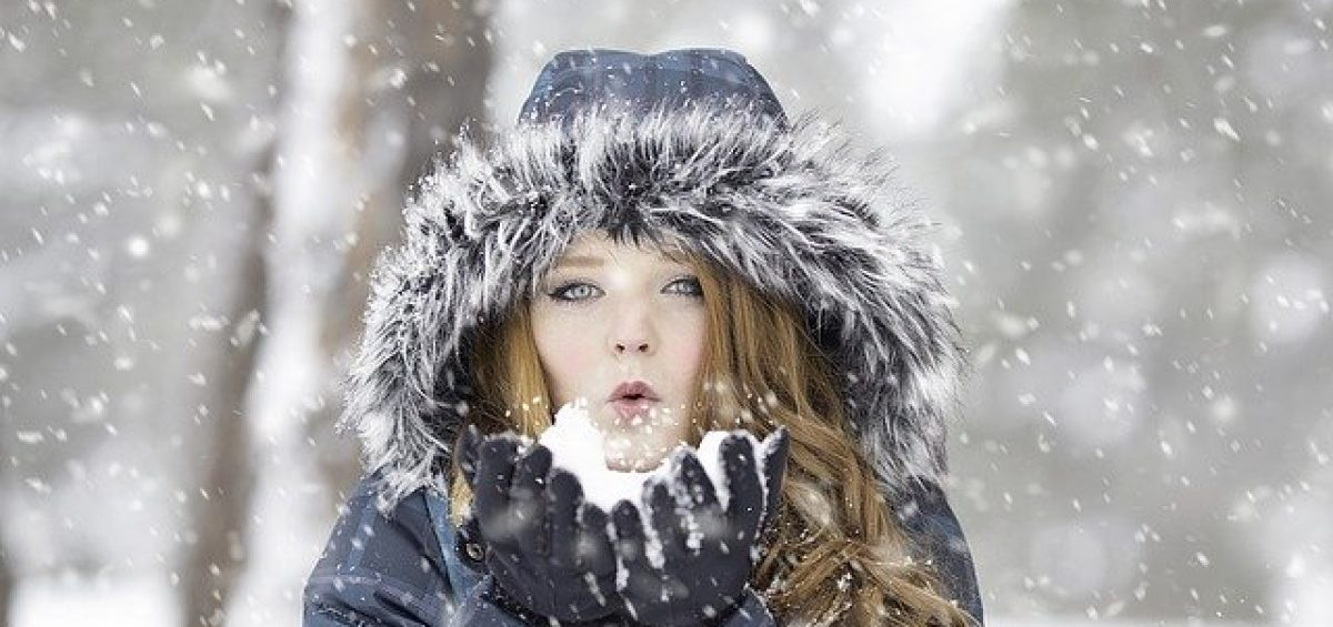 A girl on snow that shows how cleaning your storage during the winter could be hard