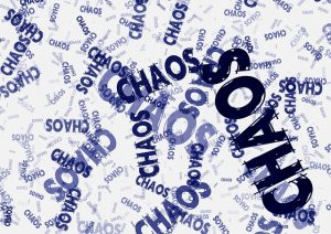 Chaos words spread all over the image, chaotically.