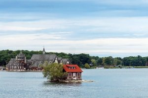 A small house on the island in the middle of the lake.