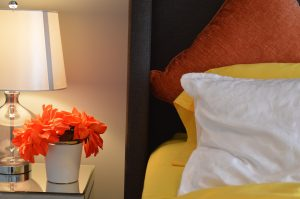 bed and bedside table and lamp