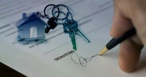 Signing a house contract after moving to Seattle.