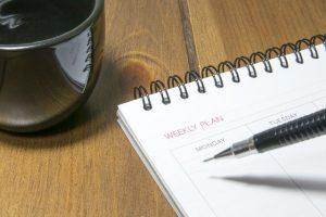 A pen and a calendar notebook.