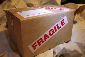 """A box with the word """"fragile"""" on sides."""