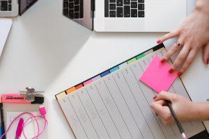 A woman writing down a plan.