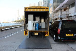 A moving truck loaded with some household items.