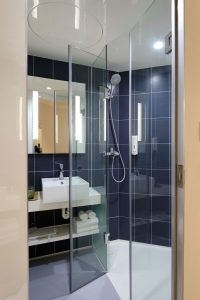 Bathroom ugrade is a shower door.