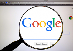 A view of the Googe Search Engine through a magnifying glass.