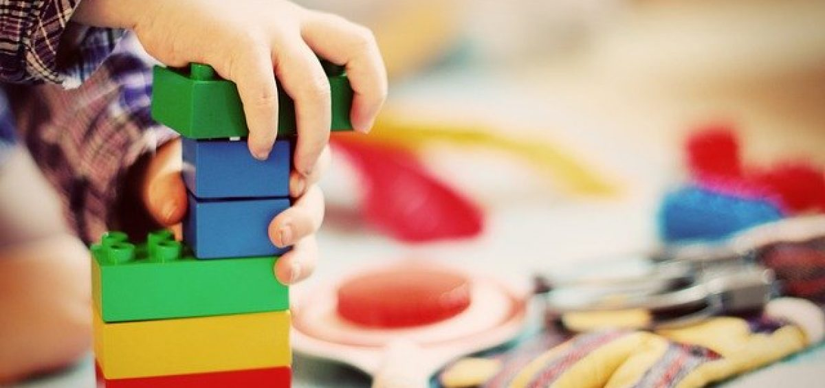 A kid playing with legos.