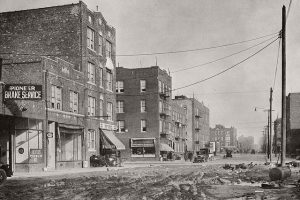 A black and white photo of the old NYC and a street in one of the Big Apple's forgotten neighborhoods.
