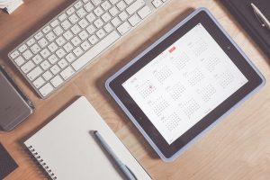 A calendar ona tablet lying on the desk.