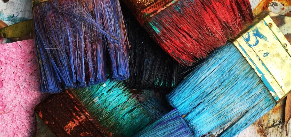 Paint brushes with paint ready for spring renovation tips.