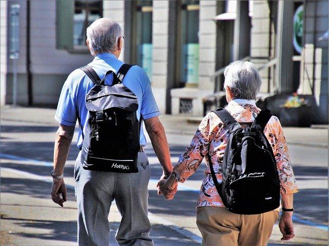 2 seniors walking.