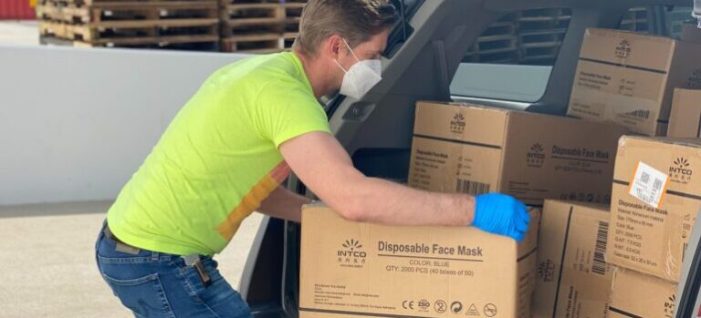 Guy moving boxes to suburban Boston.