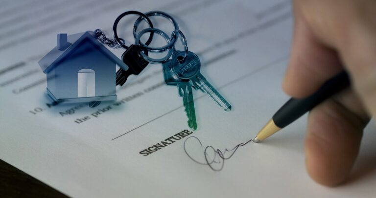 man signing a contract after investing in South Austin real estate