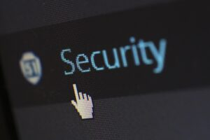 A mouse on a computer screen pointing to the word security