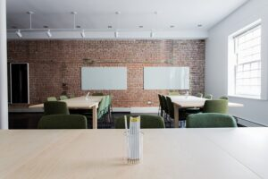 Modern office space in Washington DC with a brick wall.
