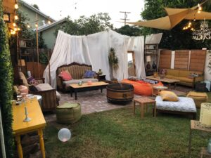 An old-fashioned yard sale. If you're wondering what to do with extra furniture this is one way to go.