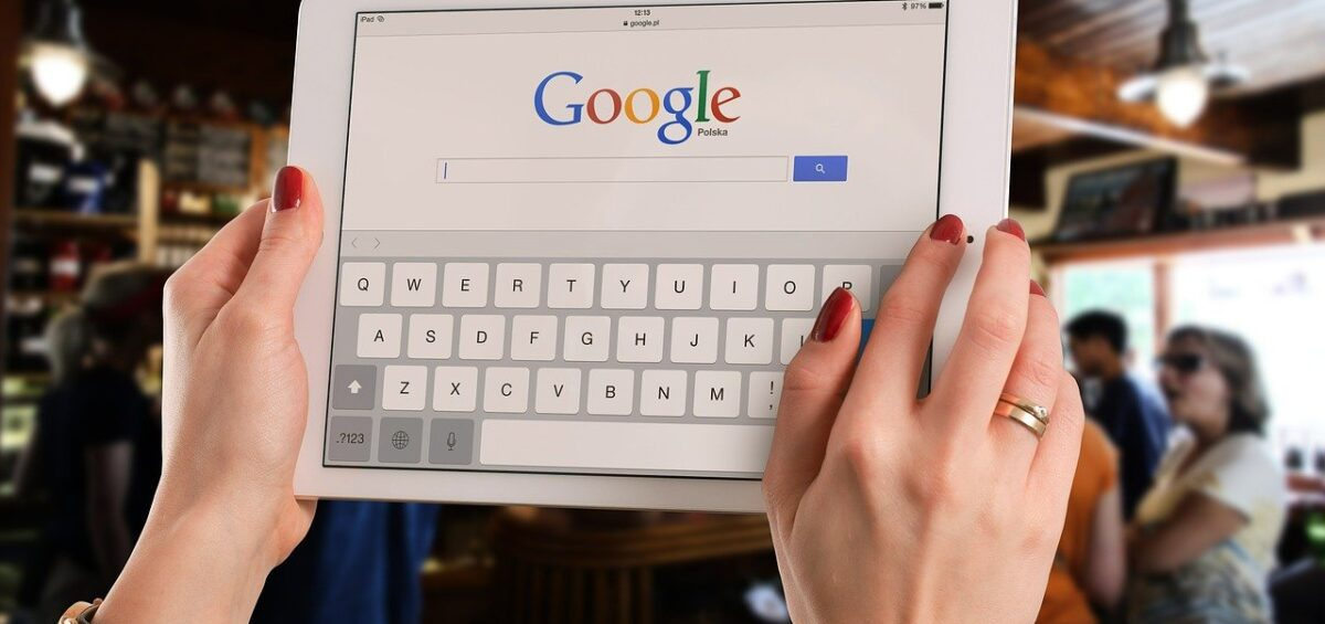 A woman using Google on her tablet to find reliable moving crews