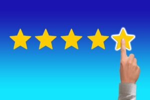 Finger pointing on the five-star review.