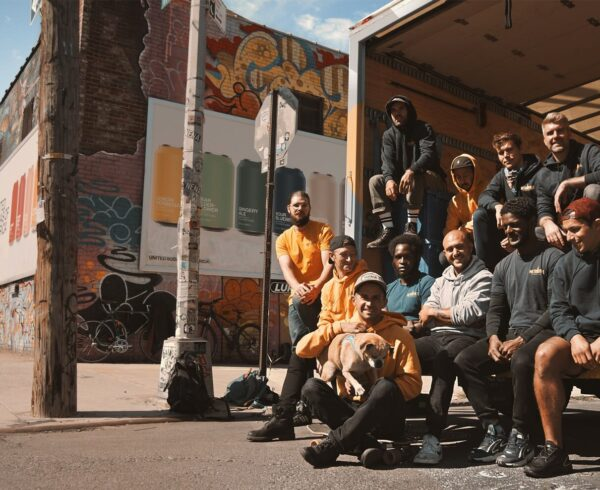 A moving crew in front of their truck. If you want to go through the moving process without much stress you should hire professional movers.