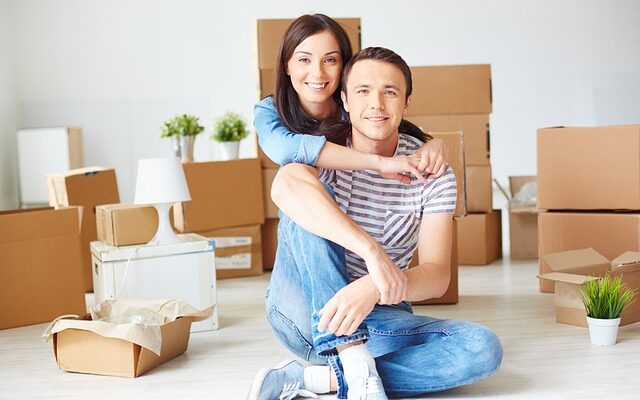 Couple with boxes.