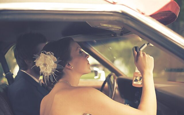 A couple in the car is searching for one of the best neighborhoods in Mount Prospect for newly-weds.