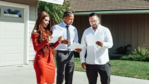 a couple reading a closing disclosure wth their real estate agent