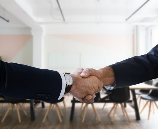 A handshake after finding the best moving deals.