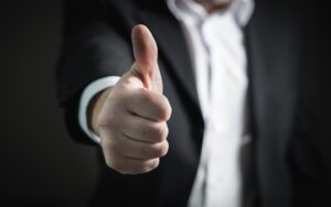A person showing thumb up.