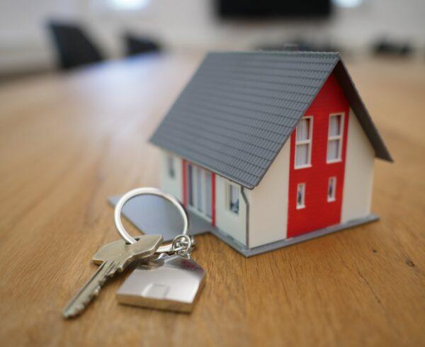 A house-shaped keyring and a key